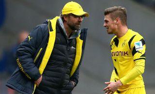Trener Borussii Dortmund Juergen Klopp i Łukasz Piszczek